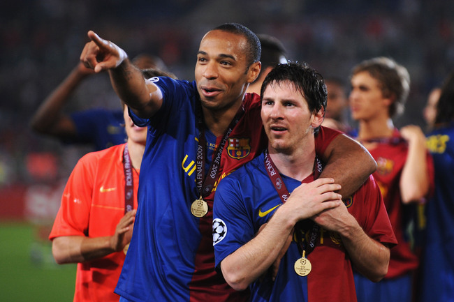 ROME - MAY 27:  Thierry Henry of Barcelona and Lionel Messi of Barcelona celebrate winning the UEFA Champions League Final match between Manchester United and Barcelona at the Stadio Olimpico on May 27, 2009 in Rome, Italy. Barcelona won 2-0.  (Photo by S