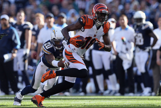 SAN DIEGO, CA - DECEMBER 02:  Wide receiver A.J. Green #18 of the Cincinnati Bengals is pursued by cornerback Antoine Cason #20 of the San Diego Chargers in the first half at Qualcomm Stadium on December 2, 2012 in San Diego, California. The Bengals defea