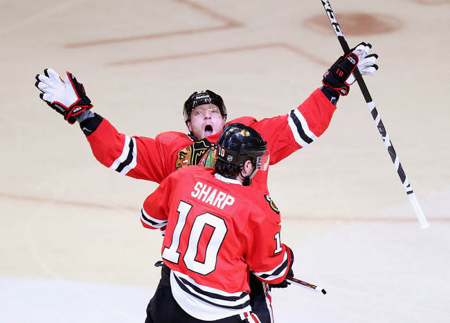 CHICAGO, IL - MAY 15: Marian Hossa #81 of the Chicago Blackhawks celebrates a first period goal with teammate Patrick Sharp #10 against the Detroit Red Wings in Game One of the Western Conference Semifinals during the 2013 NHL Stanley Cup Playoffs at the