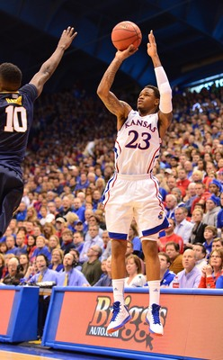 Mar 2, 2013; Lawrence, KS, USA; Kansas Jayhawks guard Ben McLemore (23) hits a three-point shot against the West Virginia Mountaineers during the first half at Allen Fieldhouse. Mandatory Credit: Peter G. Aiken-USA TODAY Sports