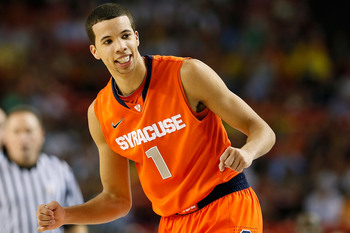 ATLANTA, GA - APRIL 06:  Michael Carter-Williams #1 of the Syracuse Orange reacts in the first half against the Michigan Wolverines during the 2013 NCAA Men's Final Four Semifinal at the Georgia Dome on April 6, 2013 in Atlanta, Georgia.  (Photo by Kevin