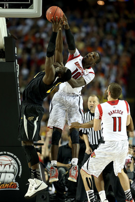 ATLANTA, GA - APRIL 06: Ehimen Orukpe #21 of the Wichita State Shockers reaches for the ball in the second half against Gorgui Dieng #10 of the Louisville Cardinals  during the 2013 NCAA Men's Final Four Semifinal at the Georgia Dome on April 6, 2013 in A