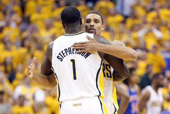 INDIANAPOLIS, IN - MAY 18:  George Hill #3 and Lance Stephenson #1 of the Indiana Pacers celebrate in the game against the New York Knicks during Game Six of the Eastern Conference Semifinals of the 2013 NBA Playoffs at Bankers Life Fieldhouse on May 18,