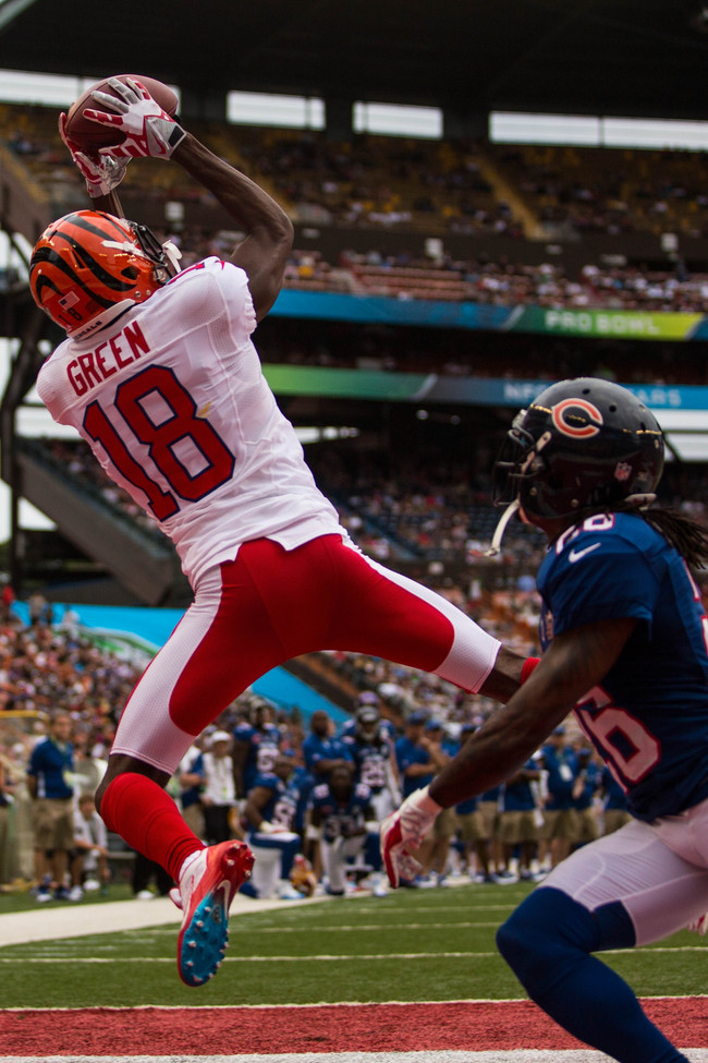 HONOLULU, HI - JANUARY 27:  A.J. Green #18 of the AFC's Cincinnati Bengals catches a pass over Tim Jennings #26 of the NFC's Chicago Bears during the 2013 AFC-NFC Pro Bowl on January 27 , 2013 at Aloha Stadium in Honolulu, Hawaii.  (Photo by Kent Nishimur