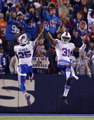 ORCHARD PARK, NY - NOVEMBER 15:  Jairus Byrd #31 and  Da'Norris Searcy #25 of the Buffalo Bills celebrate Byrd's interception in the fourth quarter against the Miami Dolphins at Ralph Wilson Stadium on November 15, 2012 in Orchard Park, New York. Buffalo