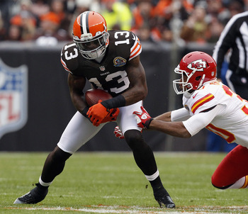 CLEVELAND, OH - DECEMBER 09:  Wide receiver Josh Gordon #13 of the Cleveland Browns makes a catch in front of cornerback Jalil Brown #30 of the Kansas City Chiefs at Cleveland Browns Stadium on December 9, 2012 in Cleveland, Ohio.  (Photo by Matt Sullivan