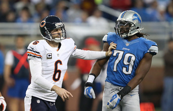 DETROIT, MI - DECEMBER 30: Jay Cutler #6 of the Chicago Bears gives Willie Young #79 of the Detroit Lions a push during the game at Ford Field on December 30, 2012 in Detroit, Michigan. The Bears defeted the Lions 26-24.  (Photo by Leon Halip/Getty Images