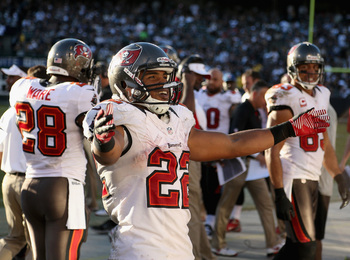 OAKLAND, CA - NOVEMBER 04:  Doug Martin #22 of the Tampa Bay Buccaneers celebrates afte the bench after he scored a touchdown against the Oakland Raiders at O.co Coliseum on November 4, 2012 in Oakland, California.  (Photo by Ezra Shaw/Getty Images)