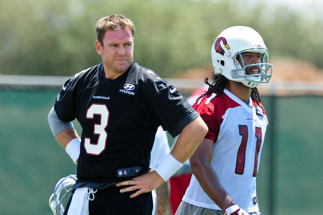 May 14, 2013; Tempe, AZ, USA; Arizona Cardinals quarterback Carson Palmer (3) and wide receiver Larry Fitzgerald (11) looks on during organized team activities at the Cardinals Training Facility.  Mandatory Credit: Matt Kartozian-USA TODAY Sports