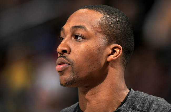 DENVER, CO - FEBRUARY 25:  Dwight Howard #12 of the Los Angeles Lakers looks on during warm ups prior to facing the Denver Nuggets at the Pepsi Center on February 25, 2013 in Denver, Colorado. The Nuggets defeated the Lakers 119-108. NOTE TO USER: User ex