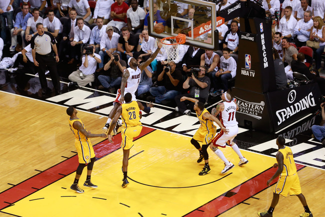MIAMI, FL - MAY 22: LeBron James #6 of the Miami Heat drives to the basket against Paul George #24 of the Indiana Pacers during Game One of the Eastern Conference Finals at AmericanAirlines Arena on May 22, 2013 in Miami, Florida. NOTE TO USER: User expre