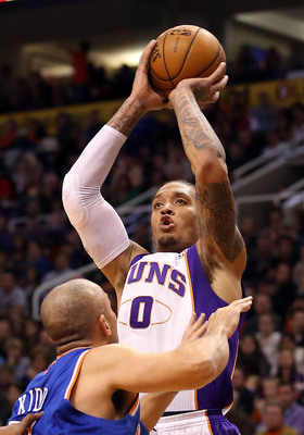 PHOENIX, AZ - DECEMBER 26:  Michael Beasley #0 of the Phoenix Suns puts up a shot over Jason Kidd #5 of the New York Knicks during the NBA game at US Airways Center on December 26, 2012 in Phoenix, Arizona.  The Knicks defeated the Suns 99-97.  NOTE TO US