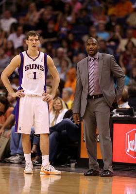 PHOENIX, AZ - APRIL 05:  Goran Dragic #1 and head coach Lindsey Hunter of the Phoenix Suns during the NBA game against the Golden State Warriors at US Airways Center on April 5, 2013 in Phoenix, Arizona.  NOTE TO USER: User expressly acknowledges and agre