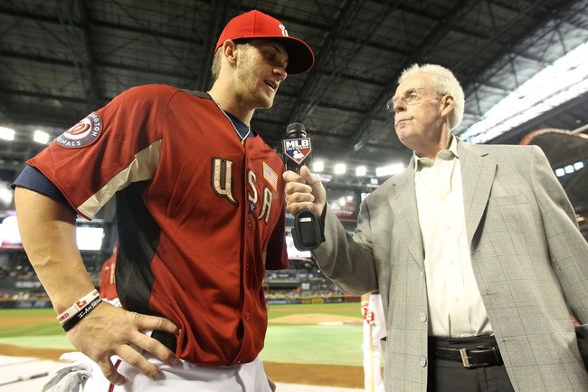 PHOENIX, AZ - JULY 10:  U.S. Futures All-Star Bryce Harper #34 of the Washington Nationals is interviewed by Peter Gammons of the MLB Network prior to the 2011 XM All-Star Futures Game at Chase Field on July 10, 2011 in Phoenix, Arizona.  (Photo by Christ