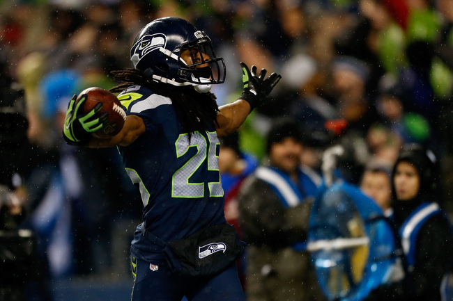 SEATTLE, WA - DECEMBER 23:  Richard Sherman #25 of the Seattle Seahawks reacts after ne intercepted a pass in the second half against the San Francisco 49ers at Qwest Field on December 23, 2012 in Seattle, Washington.  (Photo by Otto Greule Jr/Getty Image