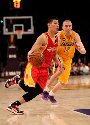 LOS ANGELES, CA - APRIL 17:  Jeremy Lin #7 of the Houston Rockets drives past Steve Blake #5 of the Los Angeles Lakers at Staples Center on April 17, 2013 in Los Angeles, California. The Lakers won 99-95 in overtime.   NOTE TO USER: User expressly acknowl