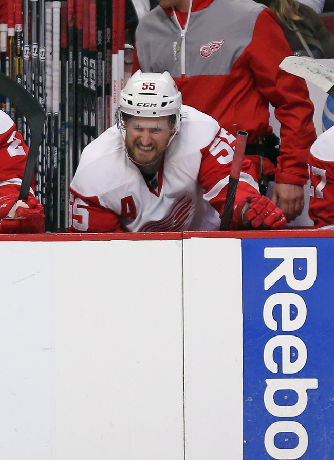 CHICAGO, IL - MAY 25: Niklas Kronwall #55 of the Detroit Red Wings grimaces on the bench after suffering a hit by the Chicago Blackhawks in Game Five of the Western Conference Semifinals during the 2013 NHL Stanley Cup Playoffs at the United Center on May