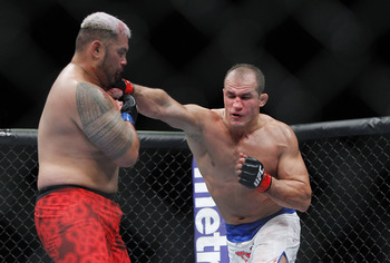 May 25, 2013; Las Vegas, NV, USA; Junior dos Santos lands a punch against Mark Hunt during UFC 160 at the MGM Grand Garden Arena. Mandatory Credit: Gary A. Vasquez-USA TODAY Sports
