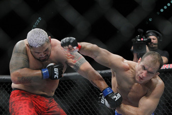 May 25, 2013; Las Vegas, NV, USA; Junior dos Santos lands a punch on Mark Hunt during UFC 160 at the MGM Grand Garden Arena. Mandatory Credit: Gary A. Vasquez-USA TODAY Sports
