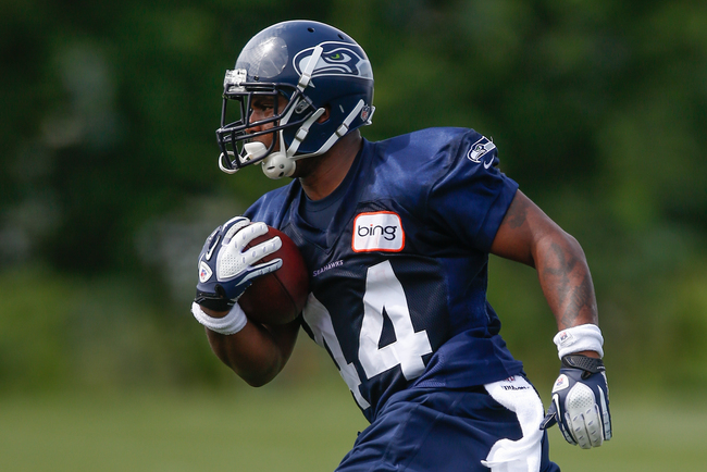 RENTON, WA - MAY 11:  Running back Spencer Ware #44 of the Seattle Seahawks rushes during Rookie Camp at the Virginia Mason Athletic Center on May 11, 2013 in Renton, Washington.  (Photo by Otto Greule Jr/Getty Images)