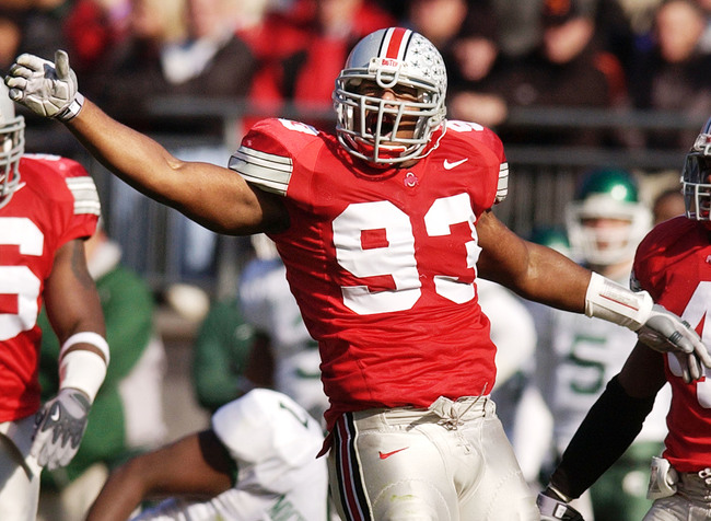 COLUMBUS, OH - NOVEMBER 8:  Will Smith #93 of the Ohio State Buckeyes celebrates making a play against the Michigan State Spartans during the first quarter on November 8, 2003 at Ohio Stadium in Columbus, Ohio.  Ohio State defeated Michigan State 33-23. (