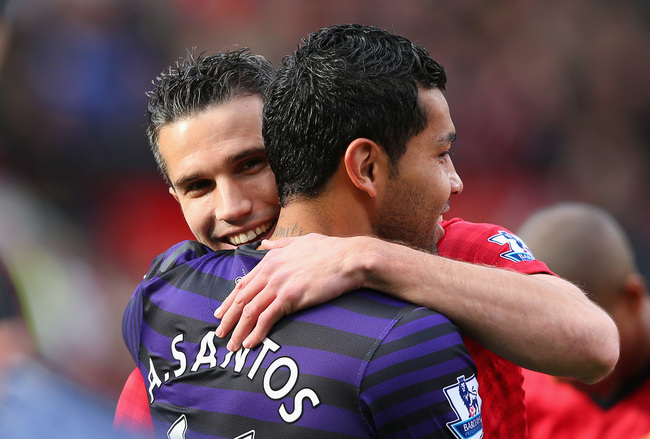 MANCHESTER, ENGLAND - NOVEMBER 03:  Robin van Persie of Manchester United embraces Andre Santos of Arsenal prior to the Barclays Premier League match between Manchester United and Arsenal at Old Trafford on November 3, 2012 in Manchester, England.  (Photo