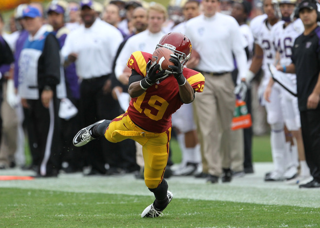 LOS ANGELES, CA - NOVEMBER 12:  Wide receiver Brice Butler #19 of the USC Trojans makes a diving catch for a 36 yard gain in the first quarter against the Washington Huskies at the Los Angeles Memorial Coliseum on November 12, 2011 in Los Angeles, Califor