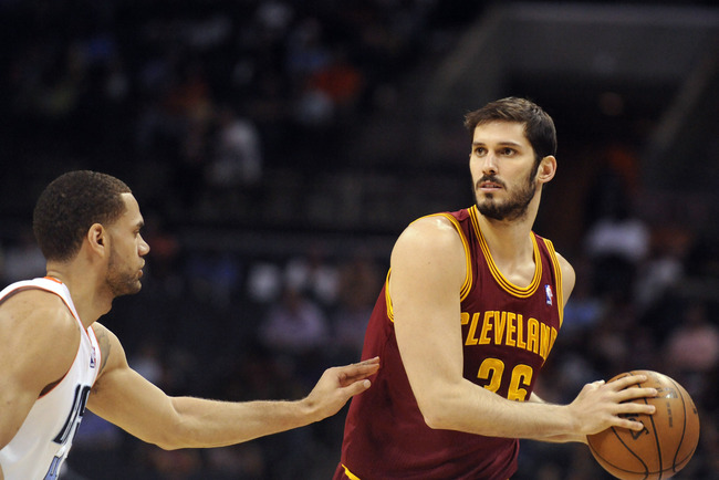 April 17, 2013; Charlotte, NC, USA; Cleveland Cavaliers forward Omri Casspi (36) looks to pass as he is defended by Charlotte Bobcats forward Jeffery Taylor (44) during the game at Time Warner Cable Arena. Mandatory Credit: Sam Sharpe-USA TODAY Sports