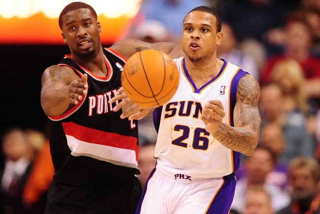 Jan. 6, 2012; Phoenix, AZ, USA; Phoenix Suns guard Shannon Brown (right) passes the ball under pressure form Portland Trail Blazers guard Wesley Matthews at the US Airways Center. The Suns defeated the Trail Blazers 102-77. Mandatory Credit: Mark J. Rebil