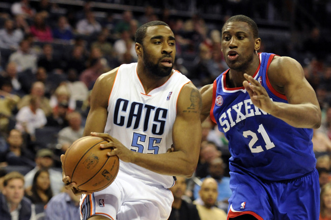April 3, 2013; Charlotte, NC, USA; Charlotte Bobcats guard Reggie Williams (55) drives to the basket as he is defended by Philadelphia 76ers forward Thaddeus Young (21) during the game at Time Warner Cable Arena. Bobcats win 88-83. Mandatory Credit: Sam S