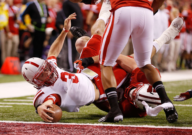 INDIANAPOLIS, IN - DECEMBER 01: Taylor Martinez #3 of the Nebraska Cornhuskers stretches for a third quarter touchdown during the Big 10 Conference Championship Game at Lucas Oil Stadium on December 1, 2012 in Indianapolis, Indiana. Wisconsin won the game