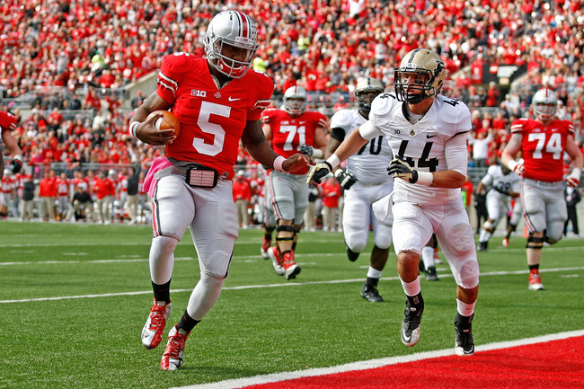 COLUMBUS, OH - OCTOBER 20:  Braxton Miller #5 of the Ohio State Buckeyes runs past Landon Feichter #44 of the Purdue Boilermakers during the first quarter on October 20, 2012 at Ohio Stadium in Columbus, Ohio. (Photo by Kirk Irwin/Getty Images)