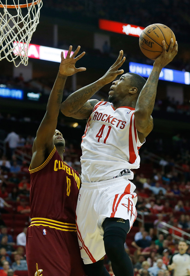 HOUSTON, TX - MARCH 22:  Thomas Robinson #41 of the Houston Rockets goes up for a shot over C.J. Miles #0 of the Cleveland Cavaliers at Toyota Center on March 22, 2013 in Houston, Texas. NOTE TO USER: User expressly acknowledges and agrees that, by downlo
