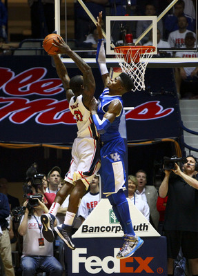 Jan 29, 2013; Memphis, TN, USA;  Mississippi Rebels forward Murphy Holloway (31) goes up for a dunk and is guarded by Kentucky Wildcats forward Nerlens Noel (3) during the game at the Tad Smith Coliseum.  Kentucky Wildcats defeated the Mississippi Rebels