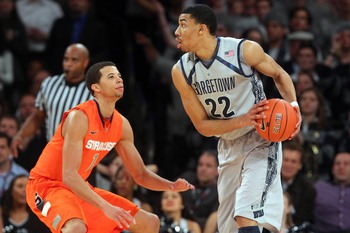 Mar 15, 2013; New York, NY, USA; Georgetown Hoyas forward Otto Porter (22) controls the ball against Syracuse Orange guard Michael Carter-Williams (1) during the second half of a semifinal game of the Big East tournament at Madison Square Garden. Mandator