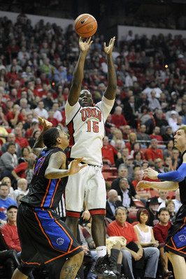 Mar 5, 2013; Las Vegas, NV, USA; UNLV Runnin' Rebels forward Anthony Bennett (15) shoots a field goal as Boise State Broncos guard Kenny Buckner (42) defends in the first half at the Thomas & Mack Center. Mandatory Credit: Josh Holmberg-USA TODAY Sports