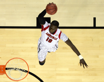 Apr 8, 2013; Atlanta, GA, USA; Louisville Cardinals center Gorgui Dieng (10) dunks against the Michigan Wolverines during the first half of the championship game in the 2013 NCAA mens Final Four at the Georgia Dome.  Mandatory Credit: Bob Donnan-USA TODAY