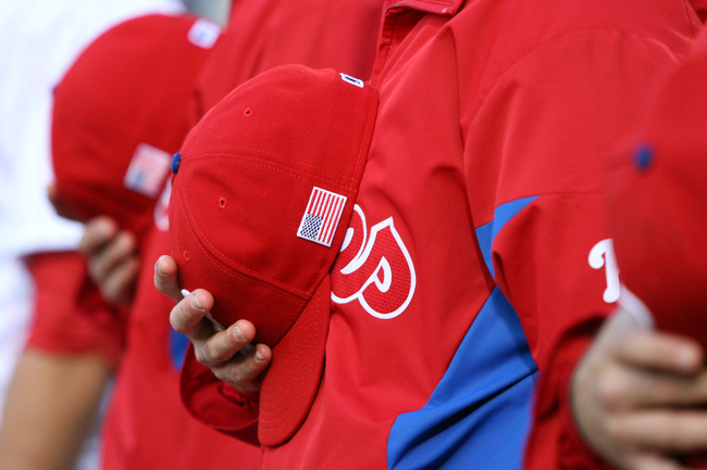 PHILADELPHIA - SEPTEMBER 11: Players of the Philadelphia Phillies display an American flag on their hats in remembrance of September 11, 2001 during a game against the Miami Marlins at Citizens Bank Park on September 11, 2012 in Philadelphia, Pennsylvania