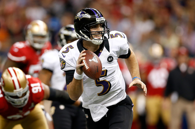 NEW ORLEANS, LA - FEBRUARY 03:  Joe Flacco #5 of the Baltimore Ravens looks to pass as he rolls out of the pocket against the San Francisco 49ers during Super Bowl XLVII at the Mercedes-Benz Superdome on February 3, 2013 in New Orleans, Louisiana.  (Photo
