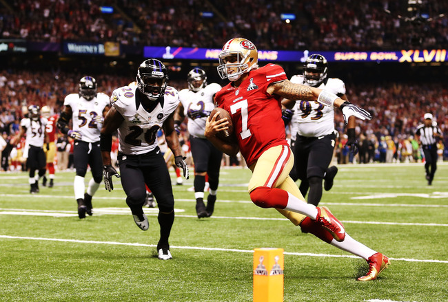 NEW ORLEANS, LA - FEBRUARY 03:  Colin Kaepernick #7 of the San Francisco 49ers scores a 15-yard rushing touchdown in the fourth quarter against Ed Reed #20 of the Baltimore Ravens during Super Bowl XLVII at the Mercedes-Benz Superdome on February 3, 2013