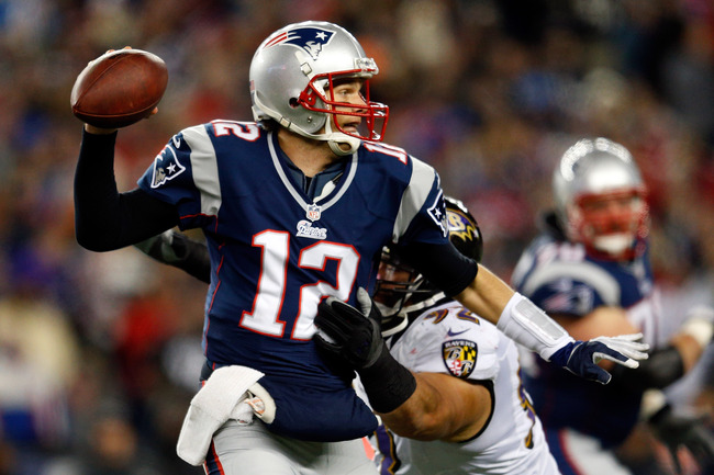 FOXBORO, MA - JANUARY 20:  Tom Brady #12 of the New England Patriots gets pressured by Haloti Ngata #92 of the Baltimore Ravens during the 2013 AFC Championship game at Gillette Stadium on January 20, 2013 in Foxboro, Massachusetts.  (Photo by Jim Rogash/