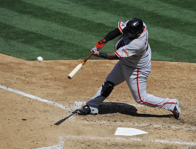 SAN DIEGO, CA - APRIL 28:   Pablo Sandoval #48 of the San Francisco Giants hits an RBI single during the fifth inning of a baseball game against the San Diego Padres at Petco Park on April 28, 2013 in San Diego, California.  (Photo by Denis Poroy/Getty Im