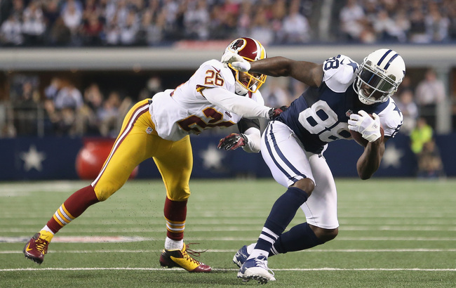 ARLINGTON, TX - NOVEMBER 22:  Dez Bryant #88 of the Dallas Cowboys and Josh Wilson #26 of the Washington Redskins at Cowboys Stadium on November 22, 2012 in Arlington, Texas.  (Photo by Ronald Martinez/Getty Images)