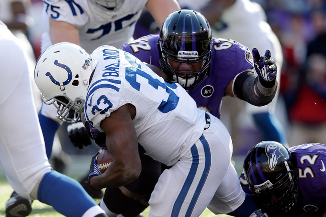 BALTIMORE, MD - JANUARY 06:  Terrence Cody #62 of the Baltimore Ravens tackles Vick Ballard #33 of the Indianapolis Colts in the first quarter during the AFC Wild Card Playoff Game at M&T Bank Stadium on January 6, 2013 in Baltimore, Maryland.  (Photo by