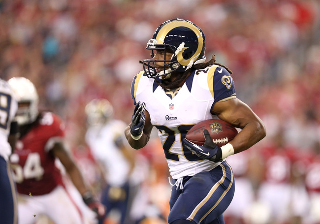 GLENDALE, AZ - NOVEMBER 25:  Running back Daryl Richardson #26 of the St. Louis Rams rushes the football against the Arizona Cardinals during the NFL game at the University of Phoenix Stadium on November 25, 2012 in Glendale, Arizona. The Rams defeated th