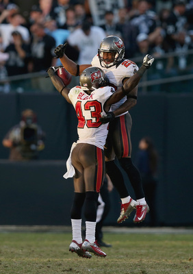 OAKLAND, CA - NOVEMBER 04: Ahmad Black #43 and Leonard Johnson #29 of the Tampa Bay Buccaneers celebrate after Black intercepted a pass in the fourth quarter of their game against the Oakland Raiders at O.co Coliseum on November 4, 2012 in Oakland, Califo