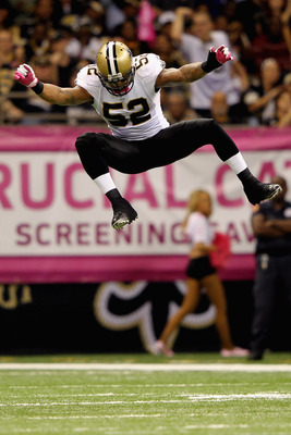 NEW ORLEANS, LA - OCTOBER 23:  Jonathan Casillas #52 of the New Orleans Saints celebrates a second quarter sack against the Indianapolis Colts at Mercedes-Benz Superdome on October 23, 2011 in New Orleans, Louisiana.  (Photo by Jamie Squire/Getty Images)