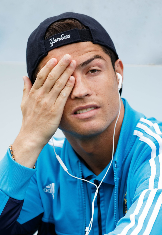 MADRID, SPAIN - MAY 26: Cristiano Ronaldo of Real Madrid CF reacts annoyed while listen to music with headphones prior to start the La Liga match between Real Sociedad de Futbol and Real Madrid CF at Estadio Anoeta on May 26, 2013 in San Sebastian, Spain.