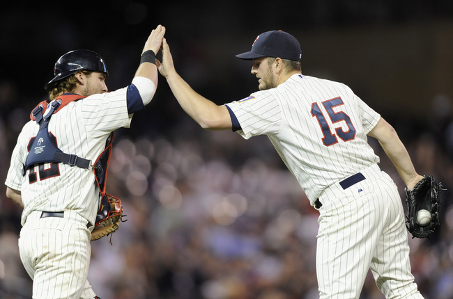 MINNEAPOLIS, MN - MAY 29: Chris Herrmann #12 and Glen Perkins #15 of the Minnesota Twins celebrate a win of the game against the Milwaukee Brewers on May 29, 2013 at Target Field in Minneapolis, Minnesota. The Twins defeated the Brewers 4-1. (Photo by Han