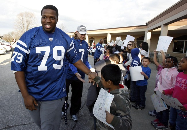 Jan 31, 2012; Indianapolis, IN, USA; Indianapolis Colts offensive lineman Ben Ijalana (79) greets students at Crestview Elementary School as part of the NFL Play 60 Challenge.  Mandatory Credit: Brian Spurlock-USA TODAY Sports